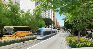 "A Nelson/Nygaard Consulting Associates Inc. report proposes building two new transit lines in downtown Rochester to help employees get to new Destination Medical Center jobs in the city's core without using cars. Although this rendering shows a streetcar, planners are also considering enhanced buses and ""elevated automated rapid transit,"" a driverless train that runs on rails above the street. (Submitted rendering: Destination Medical Center)"