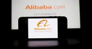 In this photo, Alibaba's application loading page is displayed on an Apple iPhone, front, and iPad in an arranged photograph in Hong Kong, China. (Bloomberg News file photo)