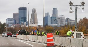 Repair crews work Tuesday on the east side of the Interstate 35W bridge over Lake Street in Minneapolis. The bridge sustained $354,000 in damage last month after being hit by a commercial vehicle. (Staff Photo: Bill Klotz)