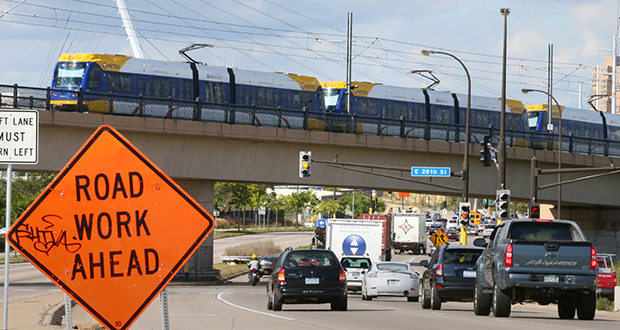 A Blue Line train crosses over Hiawatha Avenue at 28th Street in south Minneapolis. Suburban counties worry that the Met Council's 2040 Transportation Policy Plan emphasizes urban transit, bike and pedestrian options at the expense of highways, which they say could cause further congestion and safety issues. (Staff photo: Bill Klotz)