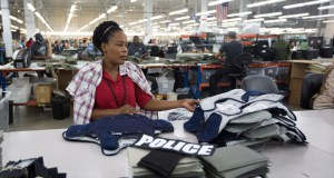 Laurette Eugene assembles a body armor vest Sept. 19 at the Point Blank Body Armor factory in Pompano Beach, Florida. The Institute for Supply Management said Wednesday that its manufacturing index fell to 56.6 from 59 in August. Anything above 50 signals that manufacturing is growing. (AP Photo: J Pat Carter)