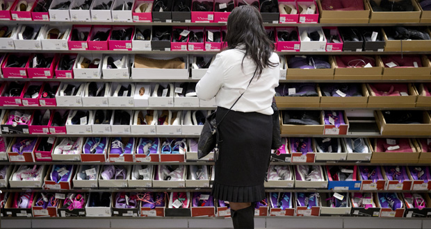 A customer shops at the new Century 21 Department Store on Oct. 28, 2014 in Philadelphia. (AP Photo: Matt Rourke)