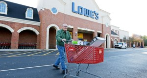 A customer leaves a Lowe's home improvement store Tuesday in Charlotte, N.C.. Lowe's reported Wednesday that its third-quarter earnings jumped 17 percent. (AP Photo: Chuck Burton)