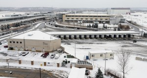 The proposed two-acre site for a full-service hotel at the Minneapolis-St. Paul International Airport is near the airport's post office facility (background). This photo was taken from the top of the Red parking ramp at Terminal 1. (Staff photo: Bill Klotz)