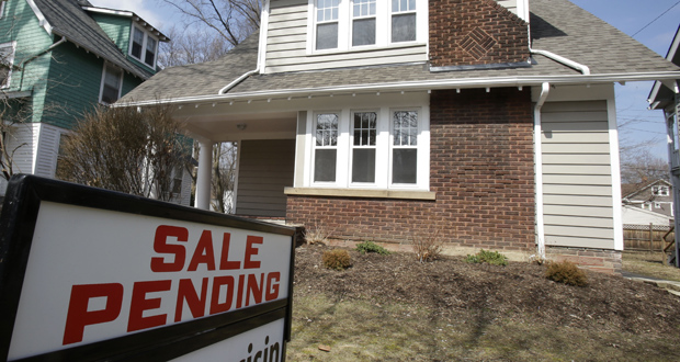 A home for sale stands March 21 in Cleveland Heights, Ohio. The National Association of Realtors reported that its seasonally adjusted pending home sales index fell 1.1 percent for October. (AP File Photo: Tony Dejak)