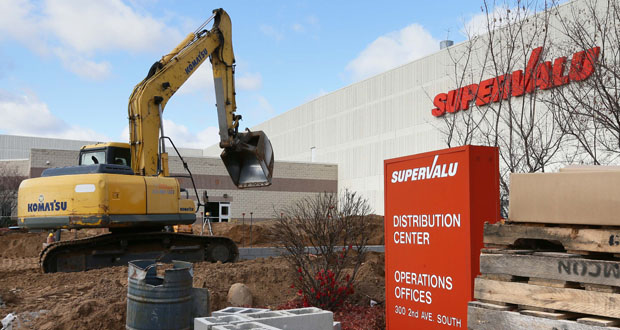 An excavator works at Supervalu's West Region Office at 300 Second Ave. S. in Hopkins. (Staff photo: Bill Klotz)
