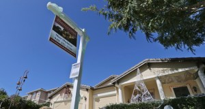 A realty sign is posted Oct. 27 in front of a home for sale in Carlsbad, California. Real estate data provider CoreLogic reported Tuesday that home prices increased 6.1 percent in October compared with 12 months earlier. (AP File Photo: Lenny Ignelzi)