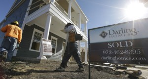 Workers return from a lunch break to a subdivision under construction Monday in Coppell, Texas. The Conference Board reported Thursday that its index of leading economic indicators increased 0.6 percent in November. (AP Photo: LM Otero)