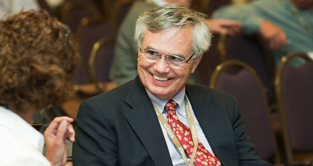 NABE President John Silvia, the chief economist at Wells Fargo, said NABE is forecasting that inflation will remain restrained in 2015 with various measures remaining below the Federal Reserve's 2 percent target for price increases. (Bloomberg News file photo)