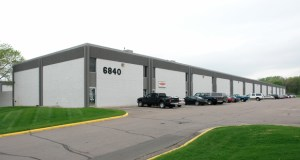 This multitenant industrial building at 6840 Shingle Creek Parkway in Brooklyn Center has sold for $3.9 million, giving the sellers nearly $1 million more than they paid when they took a risk on it in 2012. (Submitted photo: CoStar)