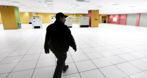 Building manager Mike Acciari walks through the data floor of the former American Express and Ameriprise data center at 1001 Third Ave. S. in Minneapolis. The building was sold this week for $22.4 million. (Staff photo: Bill Klotz)
