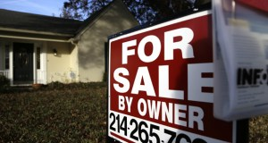 A for sale by owner sign sits in front of a home Dec. 16 in Richardson, Texas. Real estate data provider CoreLogic reported Tuesday that home prices increased 5.5 percent in November compared with 12 months earlier. (AP file photo)
