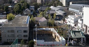 "Sengakuji temple and the condominium construction site are seen Jan. 8 in Tokyo. The ""47 ronin"" samurai who inspired the long-loved saga of loyalty and honor eulogized in films, books and plays are fighting a new kind of battle in urban Japan. An apartment complex is going up next to the curved tile-roofed Sengakuji temple where the three-century-old graves of the ronin, or masterless samurai, lie. (AP Photo: Eugene Hoshiko)"