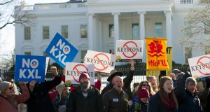 In this Jan. 10, 2015 file photo, demonstrators stand in front of the White House Jan. 10 in Washington during a rally in support of President Barack Obama's pledge to veto any legislation approving the Keystone XL pipeline. Supporters of the Keystone XL pipeline say the privately-funded, $8 billion project is a critically needed piece of infrastructure that will create thousands of jobs and make the U.S. dependent on oil from friends, rather than foes. Critics claim it will be disastrous for the pollution blamed for global warming and put communities along its 1,179-mile route at risk for an environmentally-damaging spill, all for oil and products that will be exported anyway. (AP File Photo)
