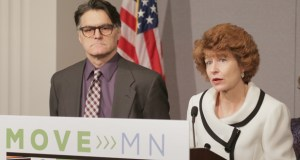Margaret Donahoe, co-chair of the Move MN coalition, announces a 10-year multi-modal transportation funding proposal Thursday at the State Office Building in St. Paul. She was joined by Dave Van Hattum of Transit for Livable Communities and other advocates. (Staff photo: Bill Klotz)