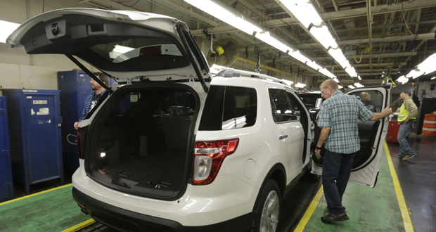 Workers perform final inspections Oct. 22 on 2015 Ford Explorers on the assembly line at the Chicago Ford Assembly Plant in Chicago. The Labor Department reported Thursday that wholesale prices fell in December by the largest amount in more than three years. (AP Photo: M. Spencer Green)