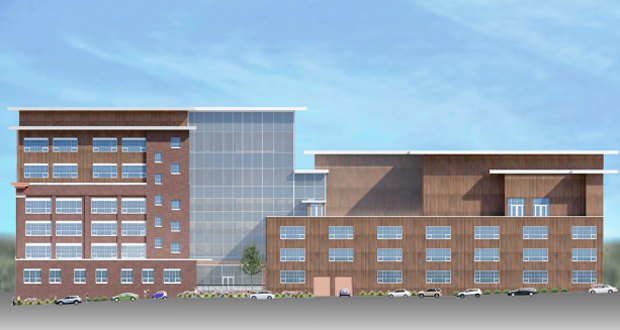 An entity related to developer Ned Abdul proposes renovating the nearly 100-year-old building at 150 26th Ave. SE in Minneapolis into an apartment complex with 320 units. The Stadium View apartments are immediately west of the site. (Submitted rendering: David J. Kelly Architect Inc.)