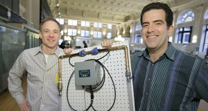 Water Meter Solutions co-founders Colin Hirdman, left, and Josh Becerra pose with the H20 Pro, which monitors water usage of an entire building. (Staff photo: Bill Klotz)