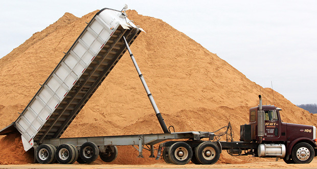 In this February 2013 file photo, a truck dumps a load of silica sand at Modern Transport Rail loading terminal in Winona, Minnesota. (AP FILE Photo: The Winona Daily News)