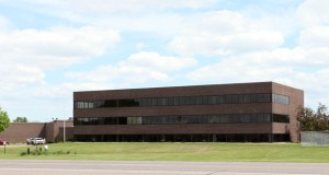 This 239,458-square-foot office and manufacturing facility in Anoka, originally known as 1055 W. Main Street and later as 1 Eniva Way, now is known as 1 ATK Way. (Submitted photo: CoStar)