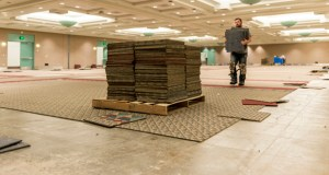 Workers remove carpet tiles from the Minneapolis Convention Center, 1301 Second Ave. S., as part of a renovation project. The tiles are available for purchase at Habitat for Humanity ReStores in Willmar and Mankato. (Submitted photo)