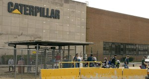 """Workers leave the Transmission unit of a Caterpillar Inc. plant in East Peoria, Illinois in April 2004. Caterpillar has disclosed that the IRS has """"proposed"""" tax increases and penalties of about $1 billion after examining the company's U.S. tax returns for 2007 to 2009. (Bloomberg file photo)"""