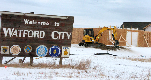 New construction projects are built Jan. 14 in Watford City, North Dakota. New neighborhoods and retail centers creep ever deeper into former wheat fields in Watford, the century-old town that once marked the end of the line for the Great Northern Railroad. Shifting oil market threatens to put the industry and local governments on a collision course. (AP Photo: Matthew Brown)