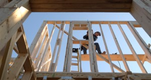 Construction worker David Rager, 53, frames a window in the upper floor of a two-story custom home being built Feb. 13 in Orlando, Florida. The National Association of Home Builders/Wells Fargo reported that homebuilders are feeling slightly less confident in their sales prospects in February. (AP File Photo)