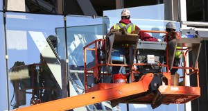 Crews install glass panels Friday on the east side of the Vikings stadium under construction in downtown Minneapolis. The project is now 50 percent complete, and about $400 million worth of construction has been finished so far, according to Mortenson Construction. (Staff photo: Bill Klotz)