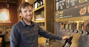 Co-founder Tom Whisenand fills a growler at Indeed Brewing, 711 NE 15th Ave. in Minneapolis. While there is little hope for repeal of the broad ban on Sunday liquor sales, lawmakers have proposed allowing Sunday growler sales by brewers. (Staff photo: Bill Klotz)