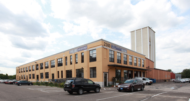 The renovated former Land O'Lakes dairy processing building and feed mill at 2300 Kennedy St. NE in Minneapolis has a variety of uses, including office and industrial space. The SR Realty Trust paid $4.05 million for the building this week. (Submitted photo: CoStar Group)