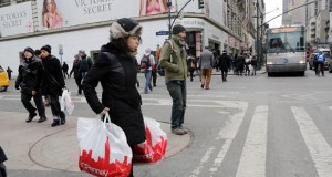 A shopper carries J.C. Penney shopping bags Feb. 19 in New York. The Commerce Department released data Thursday that showed retail sales fell 0.6 percent in February. (AP Photo: Mark Lennihan)