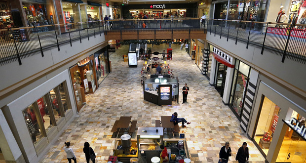 Shoppers look for deals inside the Flatiron Crossing Mall, a Macerich property in Broomfield, Colorado. Mall operator Simon Property boosted its hostile bid for rival Macerich 5 percent. Simon said, Friday, March 20, 2015, it is willing to pay $95.50 per share for Macerich, or about $16.8 billion, up from its previous offer of $91 per share, or $16 billion. (AP File Photo)