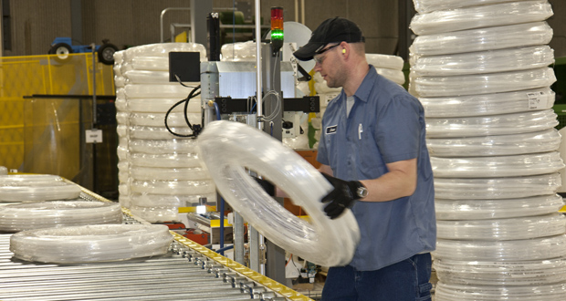 A worker at the Uponor Apple Valley plant which manufactures crosslinked polyethylene (PEX) tubing for residential and commercial plumbing, radiant heating and cooling, and other uses. (Submitted photo)