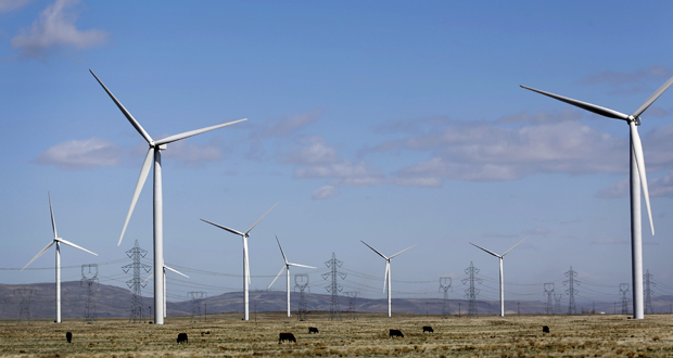 Wind turbines stand March 17, 2014, at the Caithness Shepherds Flat wind farm in Arlington, Oregon. An analysis by the U.S. Energy Department says cost reductions and technology improvements will reduce the price of wind power to below that of fossil-fuel generation, even after a $23-per-megawatt-hour subsidy provided now to wind farm owners ends. (Bloomberg photo: Meg Roussos)