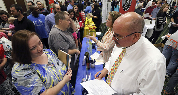 Frances Scoggins, left, speaks to Michael McCall, general manager for Chattanooga Labeling Systems, about her resume Thursday during a huge 15-county North Georgia job fair at The Colonnade in Ringgold, Ga. Scoggins has been unemployed for the past 4-months and is looking for a safety or manufacturing job. (AP Photo: Chattanooga Times Free Press, Dan Henry)
