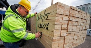 Roy Livesey marks a pallet of 2x4s on March 31 at the Allegheny Millwork and Lumberyard in Pittsburgh. The Commerce Department reported Wednesday that the U.S. economy grew at an annual rate of 0.2 percent in the first quarter. (AP Photo: Gene J. Puskar)