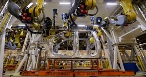 Robots fasten parts on a new 2015 aluminum-alloy body Ford F-150 truck March 13 in the body shop at the company's Kansas City Assembly Plant in Claycomo, Mo. The Commerce Department releases factory orders data Thursday that showed factory orders rose 0.2 percent in February. (AP Photo: Charlie Riedel)