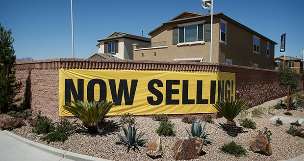A sign advertises homes for sale April 13 in Las Vegas. Standard & Poor's reported Tuesday that home prices rose 5 percent in February.  (AP Photo: John Locher)