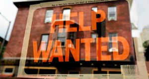 A Philadelphia business displays a help wanted sign Aug. 19, 2013, in its storefront. The Labor Department reported Thursday that weekly applications for jobless aid fell 20,000. (AP Photo: Matt Rourke, File)