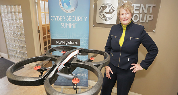 Eileen Manning, CEO of The Event Group, stands by a drone at her office in Minneapolis. (Submitted photo)