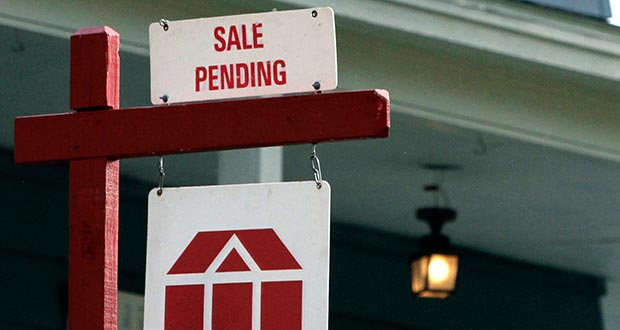 A sign announces a pending residential home sale May 8, 2014, in Framingham, Mass. The National Association of Realtors reported Wednesday that its seasonally adjusted pending home sales index rose 1.1 percent in March. (AP File Photo)