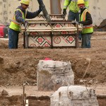 Workers pour concrete for the first footings for the stadium in April 2014. (File photo: Bill Klotz)