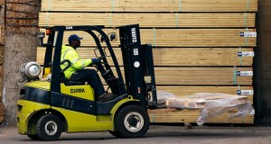 Pallets of lumber are moved March 31 at the Allegheny Millwork and Lumberyard in Pittsburgh. The Commerce Department reported Wednesday that business stockpiles increased 0.1 percent in March. (AP file photo)