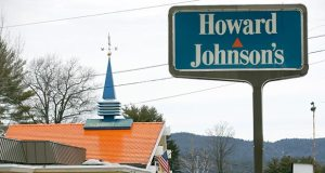 Customers walk into Howard Johnson's Restaurant on April 8 in Lake George, N.Y. The HoJo's on the main strip of the Adirondack Mountain resort town of Lake George and another in Bangor, Maine, are the last two restaurants operating under the famous name. (AP Photo: Mike Groll)