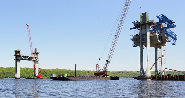 "With help from a ""segment lifter"" imported from Europe, crews on Thursday lifted 90-ton concrete segments into place on the pier closest to the Minnesota side of the river for the St. Croix Crossing project. (Staff photo: Bill Klotz)"