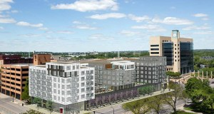 Ryan Cos. and Shorenstein are proposing 100 Hennepin, a 170-unit residential project immediately south of the Federal Reserve Bank building in Minneapolis (right). (Submitted rendering: ESG Architects)