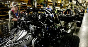 In this March 13 photo, workers install an engine in a new aluminum-alloy body Ford F-150 truck at the company's plant in Claycomo, Missouri. Durable goods orders slipped in April, but business investment climbed for a second month, a hopeful sign that this key sector is starting to revive. (AP file photo)