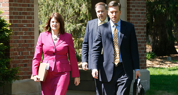 House Republican leaders arrive Wednesday at the governor's residence in St. Paul for negotiations on the state's budget. House Speaker Kurt Daudt, right, is accompanied by Majority Leader Joyce Peppin, left, and House Ways and Means Committee Chairman Jim Knoblach. (AP photo: Jim Mone)