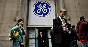 General Electric Co. has put virtually all of its U.S. commercial loan businesses on the market after hiring banks to unload $20 billion of assets in its health care, railcar and franchise finance divisions, according to people with knowledge of the matter. This photo shows a General Electric Co. logo hanging above the entrance to a building where a GE news conference was being held in October 2009 in New York. (Bloomberg file photo)